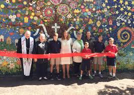 meaningful mosaic masterpiece at svdp the buzz magazines from left monsignor bill from st vincent de paul catholic church svdp principal carolyn sears sixth grader george antill parent and creator of design