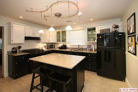 blue bottom cabinets with black appliances