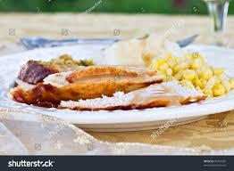 thanksgiving stuffed turkey breast thanksgiving dinner plate sliced turkey breast stock photo