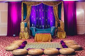 mehndi decoration bold gem tones for the mehndi sangeet dholki stage backdrop
