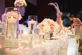 table centerpieces with candles a romantic reception decoration with ruffles and crystals