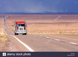 American Flag On Truck Red Truck With An American Flag On The Cooler Drives On A Long