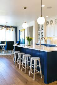 white kitchen island with stools christmas lights decoration