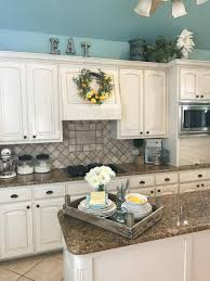 how to decorate above kitchen cabinets 2020 wow me on the weekend decorating above cabinets county