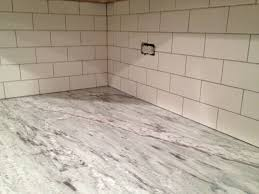 Subway Tile Backsplash In Kitchen Kitchen Marble Countertop On L Shape Cabinet Pelling White With