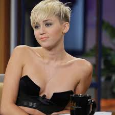 miley cyrus shows skin for a chat with jay leno pictures