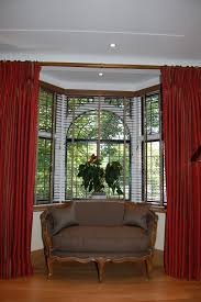 Unusual Draperies by Sofa Unique Bay Window Treatments Tamingthesat