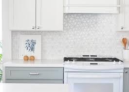 white kitchen cabinets with hexagon backsplash white iridescent hexagon tile kitchen backsplash