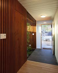 home design wooden slats and gabion wall filled with boulders