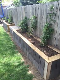 raised garden bed along fence final phase used leftover roof