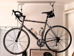 Bike Hanger Ceiling by Garage Simple White Pvc Bike Rack With Bike Organizer Also