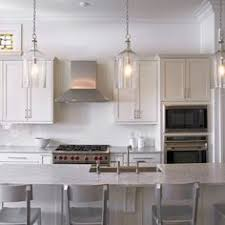 traditional kitchen light fixtures a trio of corsica pendants illuminate an extra long kitchen island