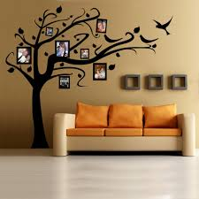 17 family photo wall ideas you can try to apply in your home decoration family photo wall design with brown tree wall decals ideas for living room design