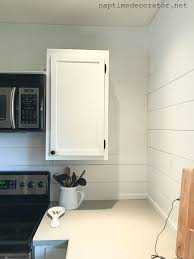how do you fill the gap between kitchen cabinets and ceiling filling an awkward kitchen space with diy wood shelves
