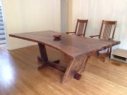 Goliath Table Hourglass Shaped Walnut Slab Dining Table With A Live Edge And A