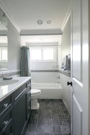 bathroom dark floor bathroom bathroom subway tiles white closet