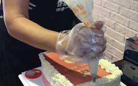 chinese woman gifted cake that dispenses cash daily mail online