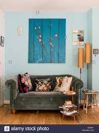 teal velvet chesterfield sofa velvet chesterfield sofa with donna read cushion underneath painting