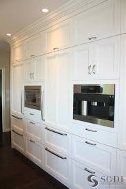 coffee maker and microwave hidden behind cabinets transitional
