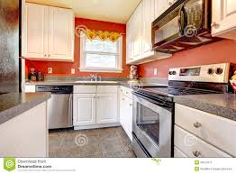 white kitchen cabinets orange walls cozy kitchen room with wall and white cabinets stock