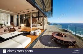 fire pit and furniture on modern luxury beach house patio with