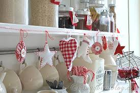 and white in the kitchen with a fabric ornament garland