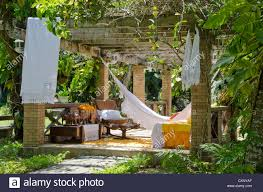 Gardens With Summer Houses - gazebo in a garden summer house with furniture and hammocks