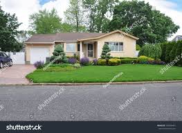 beautifully landscaped suburban one story home stock photo