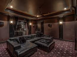 ceiling fan crown molding traditional home theater with wall sconce carpet ceiling fan