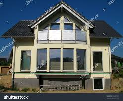 glass front modern yellow singlefamily house stock photo 101609575