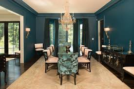 blue and taupe dining room with nickel and glass console table in