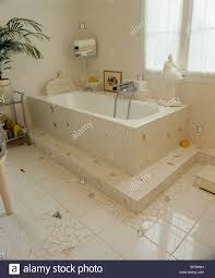 white and mirror mosaic floor and bath surround in thirties style
