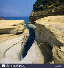 weather worn rock formation a narrow gorge with sunbathers on flat