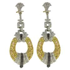 gold chandelier earrings black and white diamond sapphire white and yellow gold