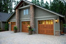 lake house paint colors with house garage doors in a stain that