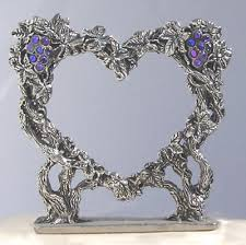 heart wedding cake toppers grape vine heart pewter wedding cake topper by fellowship foundry