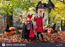 kids halloween devil costumes two funny kids wearing devil and vampire costume with red horns