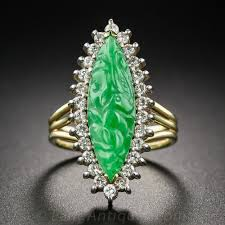 jade engagement ring carved navette shape jade and diamond ring