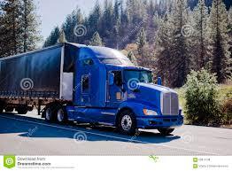 model semi trucks big modern famouse rig semi truck blue and black trailer tented