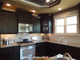 Brown Cabinet Kitchen Dark Cabinets Light Granite Countertops And Grey Vertical Subway