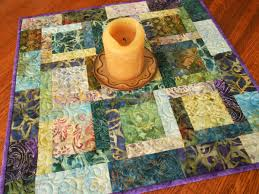quilted square table toppers quilted square table topper with batiks in shades of purple teal