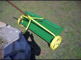 antique spreader planter painted deere green and yellow lawn