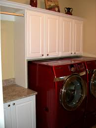 bathroom tasty laundry sink cabinet dark wood cabinets above