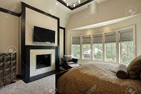 fireplace in master bedroom home design ideas master bedroom with fireplace and wall of windows stock photo 8792956