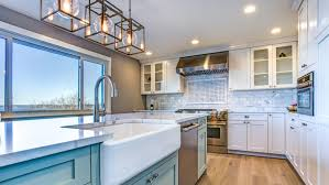 is it ok to mix stainless and white appliances here s the best way to use mixed metal in the kitchen reviewed