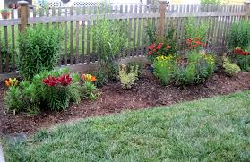 cushioned front yard fence idea using wooden with beautiful flower