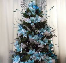 my blue motif christmas tree decorated with blue poinsettia