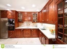 simple wooden kitchen cupboards countertops refrigerator stock
