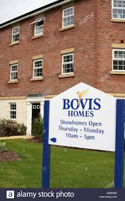 new build homes for sale on a bovis homes construction site stock