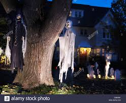 spooky halloween decoration ghosts and cemetery in the front yard